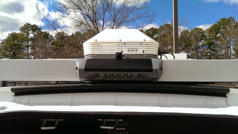 The LiveU Extender mounted on top of the truck.